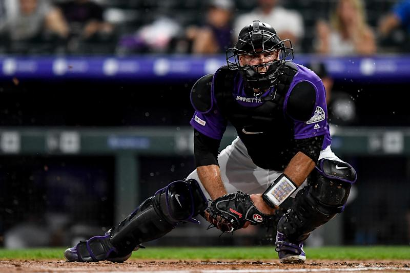 DENVER, CO - JULY 13: Chris Iannetta #22 of the Colorado Rockies holds the ball attempting to apply a tag against the Cincinnati Reds at Coors Field on July 13, 2019 in Denver, Colorado. (Photo by Dustin Bradford/Getty Images)