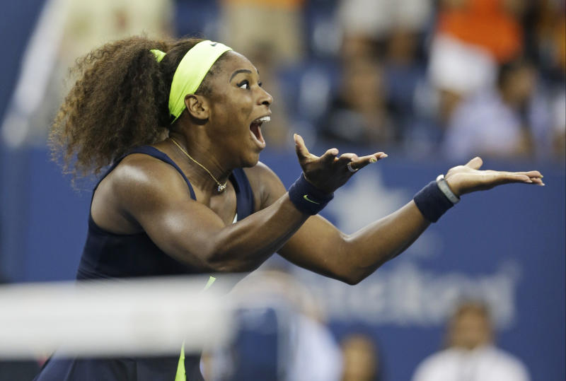 Serena Williams reacts after beating Victoria Azarenka, of Belarus, in the championship match at the 2012 US Open tennis tournament, Sunday, Sept. 9, 2012, in New York. Two points from defeat, Williams suddenly regained her composure to come back and win the last four games, beating No. 1-ranked Azarenka 6-2, 2-6, 7-5 on Sunday for her fourth U.S. Open title and 15th Grand Slam title overall. (AP Photo/Darron Cummings)