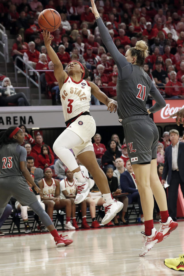North Carolina State guard Kai Crutchfield (3) drives to the basket while Louisville forward Kylee Shook (21) defends during the second half of an NCAA college basketball game in Raleigh, N.C., Thursday, Feb. 13, 2020. (AP Photo/Gerry Broome)