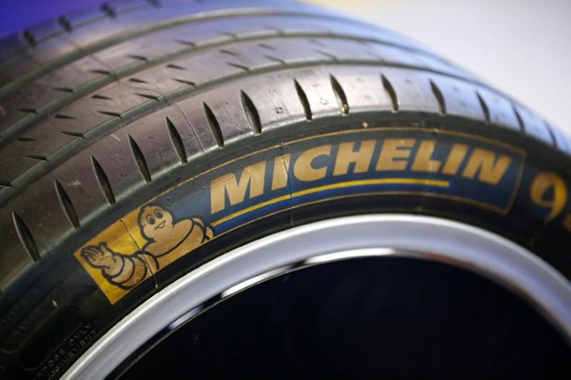 The logo of French tyre maker Michelin is seen on a tyre of a Formula E racing car