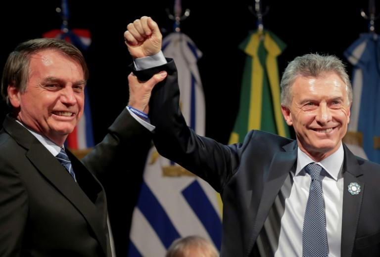 Brazil President Jair Bolsonaro (left) is taking over the Mercosur presidency from his Argentina counterpart and right-wing ally Mauricio Macri