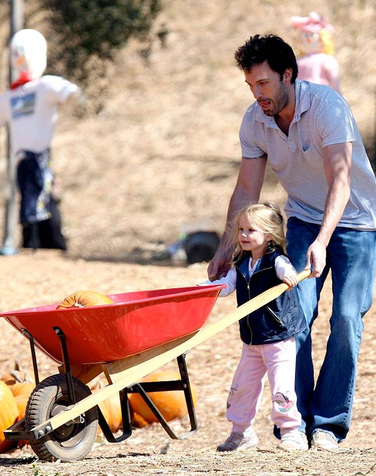 "Ben Affleck helps daughter Violet steer her wheelbarrow, while his expectant wife Jennifer Garner rests at home. <a href=""http://www.x17online.com"" target=""new"">X17 Online</a> - October 12, 2008"