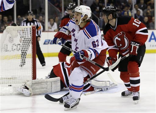 New York Rangers left wing Carl Hagelin (62), of Sweden, reacts after scoring a goal against the New Jersey Devils during the first period of an NHL hockey game, Tuesday, March 19, 2013, in Newark, N.J. (AP Photo/Julio Cortez)