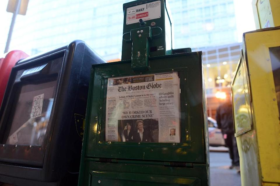 According to the Pew Research Center valuations at once-proud US metropolitan dailies, like the Boston Globe, are down by more than 90 percent from their peaks (AFP Photo/Darren McCollester)