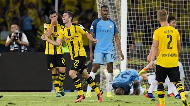<p>Christian Pulisic of Borussia Dortmund celebrates after scoring the goal to the 1:1 during the International Champions Cup China match against Manchester City during Borussia Dortmund's Summer Asia Tour on July 28, 2016 in Shenzhen, China.</p>