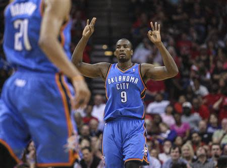 Apr 4, 2014; Houston, TX, USA; Oklahoma City Thunder forward Serge Ibaka (9) reacts after making a shot during the third quarter against the Houston Rockets at Toyota Center. The Rockets defeated the Thunder 111-107. Mandatory Credit: Troy Taormina-USA TODAY Sports