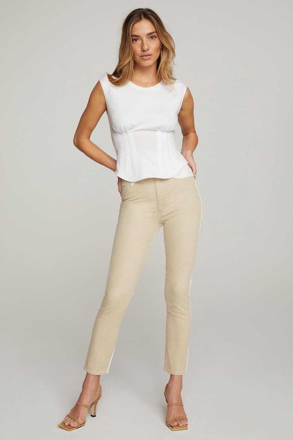 <p>This <span>Good American Corseted Tee</span> ($59) comes in four different colors, but we love the versatility of the white. If you like the look of a corset but are concerned with comfort, this is the style for you.</p>