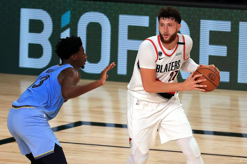 LAKE BUENA VISTA, FLORIDA - JULY 31: Jaren Jackson Jr. #13 of the Memphis Grizzlies defends Jusuf Nurkic #27 of the Portland Trail Blazers during the second half at The Arena at ESPN Wide World Of Sports Complex on July 31, 2020 in Lake Buena Vista, Florida. NOTE TO USER: User expressly acknowledges and agrees that, by downloading and or using this photograph, User is consenting to the terms and conditions of the Getty Images License Agreement. (Photo by Mike Ehrmann/Getty Images)