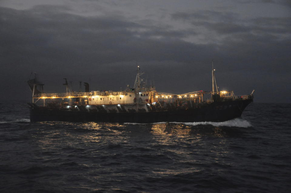 The Chinese-flagged Lu Rong Yuan Yu 609 prepares to fish for squid on the high seas near the Galapagos Islands on July 19, 2021. Fishing takes place almost exclusively at night when each ship turns on hundreds of lights as powerful than anything at a stadium to attract swarms of the fast-flying squid. The concentration of lights is so intense it can be seen from space on satellite images that show the massive fleet shining as brightly as major cities hundreds of miles away on land. (AP Photo/Joshua Goodman)
