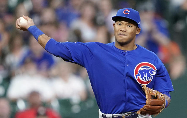 FILE - In this May 29, 2019, file photo, Chicago Cubs shortstop Addison Russell throws to first during the eighth inning of a baseball game against the Houston Astro in Houston. The Cubs failed to offer a 2020 contract to Russell on Monday, Dec. 2, 2019, making the 2016 All-Star a free agent one year after he was suspended for violating Major League Baseballs domestic violence policy. (AP Photo/David J. Phillip, File)