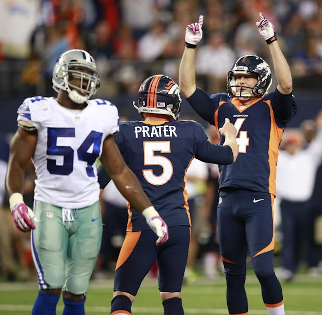 Denver Broncos punter Britton Colquitt (4) and Matt Prater (5) celebrates their winning field goal in front of Dallas Cowboys outside linebacker Bruce Carter (54) during the second half of an NFL football game Sunday, Oct. 6, 2013, in Arlington, Texas. The Broncos won 51-48. (AP Photo/Waco Tribune Herald, Jose Yau)