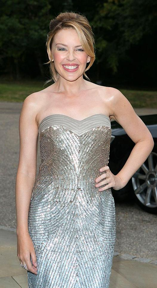 """Kylie Minogue had to postpone her """"Showgirl"""" tour when she found out in May 2005 that she had breast cancer. The Australian pop star credits her boyfriend at the time, Olivier Martinez, with helping her get through the """"dark days."""" Gareth Davies/Mission Pictures/<a href=""""http://www.gettyimages.com/"""" target=""""new"""">GettyImages.com</a> - September 7, 2009"""