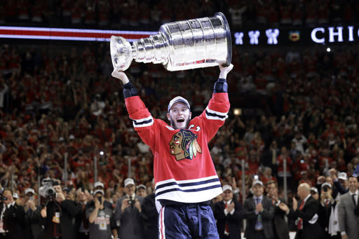 Chicago Blackhawks' Jonathan Toews hoists the Stanley Cup after defeating the Tampa Bay Lightning in Game 6 of the NHL hockey Stanley Cup Final series on Wednesday, June 10, 2015, in Chicago. The Blackhawks defeated the Lightning 2-0 to win the series 4-2. (AP Photo/Nam Y. Huh)