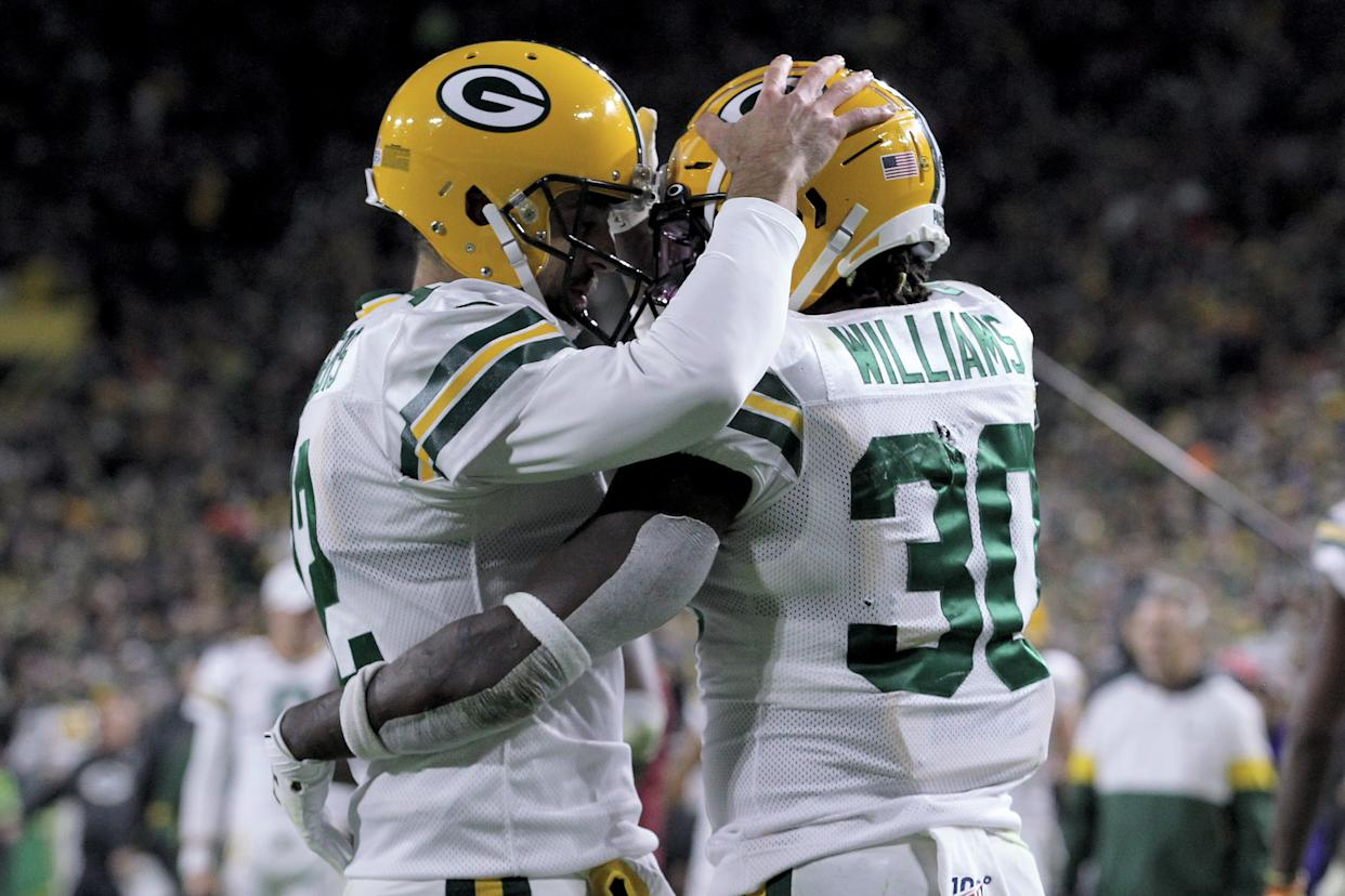 Aaron Rodgers and Jamaal Williams celebrate after a touchdown against the Lions. (Getty Images)