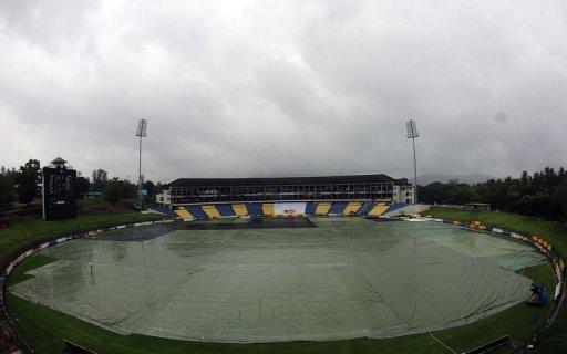 The playing surface at the Pallekele International Stadium covered with plastic sheeting