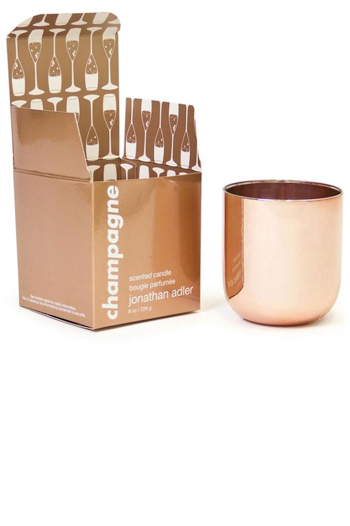 """<p>This champagne-inspired candle smells as good as it looks, with effervescent notes of pink grapefruit, raspberry, French cassis, violet leaves, rose petal, and grape leaf.</p><p><strong>Jonathan Adler </strong>Champagne Pop Candle, $42, <a rel=""""nofollow noopener"""" href=""""http://www.jonathanadler.com/decor-and-pillows/candles/champagne-pop-candle/23020.html"""" target=""""_blank"""" data-ylk=""""slk:jonathanadler.com"""" class=""""link rapid-noclick-resp"""">jonathanadler.com</a>.</p>"""