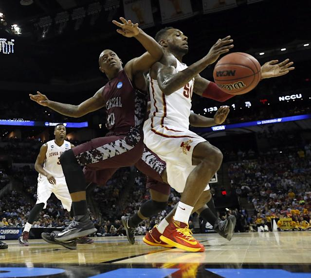 Iowa State Cyclones's DeAndre Kane (50) loses control of the ball as North Carolina Central's Alfonzo Houston (40) defends during the first half of a second-round game in the NCAA college basketball tournament Friday, March 21, 2014, in San Antonio. (AP Photo/David J. Phillip)