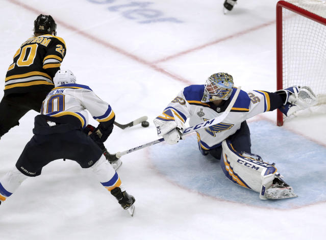 St. Louis Blues goaltender Jordan Binnington, right, stretches to make a save against Boston Bruins' Joakim Nordstrom (20), of Sweden, during the third period in Game 7 of the NHL hockey Stanley Cup Final, Wednesday, June 12, 2019, in Boston. (AP Photo/Charles Krupa)