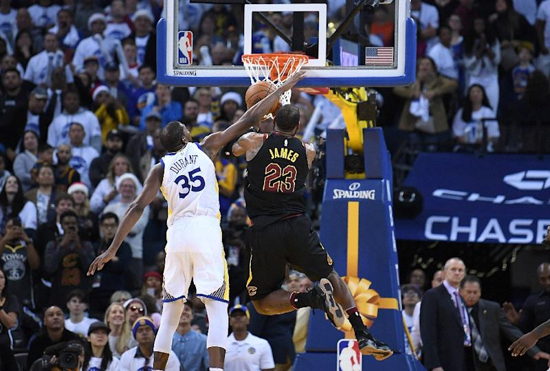 d0a8eca46 Kevin Durant  35 of the Golden State Warriors blocks the shot of LeBron  James  23 of the Cleveland Cavaliers late in the fouth quarter of their game  on ...