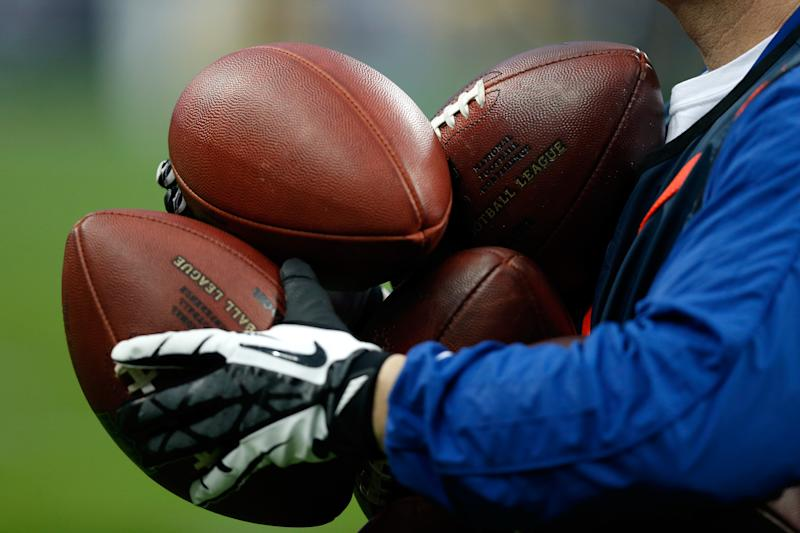 HOUSTON, TX - JANUARY 05: A detail of an official holding footballs as the Cincinnati Bengals play against the Houston Texans during their AFC Wild Card Playoff Game at Reliant Stadium on January 5, 2013 in Houston, Texas. (Photo by Scott Halleran/Getty Images)