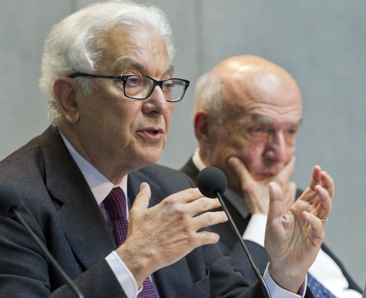 Venice Biennale of Arts President Paolo Baratta, left, with Director of the Vatican Museums Antonio Paolucci, speaks at a press conference to announce the Vatican participation at the 55th edition of the Venice Biennale of Arts, Tuesday, May 14, 2013, at the Vatican. The Vatican is getting back into its centuries-old tradition of arts patronage with its first-ever exhibit at the Venice Biennale, commissioning a biblically inspired show about creation, destruction and renewal for one of the world's most prestigious contemporary arts festivals. (AP Photo/Domenico Stinellis)