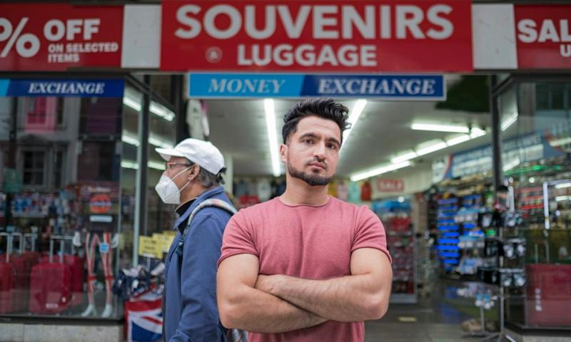 Safiq Ahmad outside the Souvenirs & Luggage store on Oxford Street.