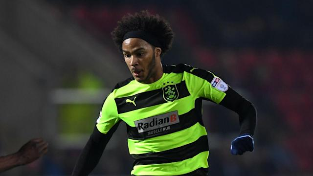 Izzy Brown's first-half goal was enough for Huddersfield to claim a 1-0 win at Wolves and book a place in the Championship play-offs.