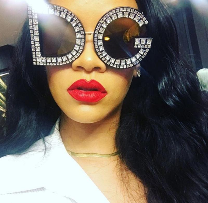 Rihanna can't stop wearing Fenty Beauty's new red lip paint, and just take our money now