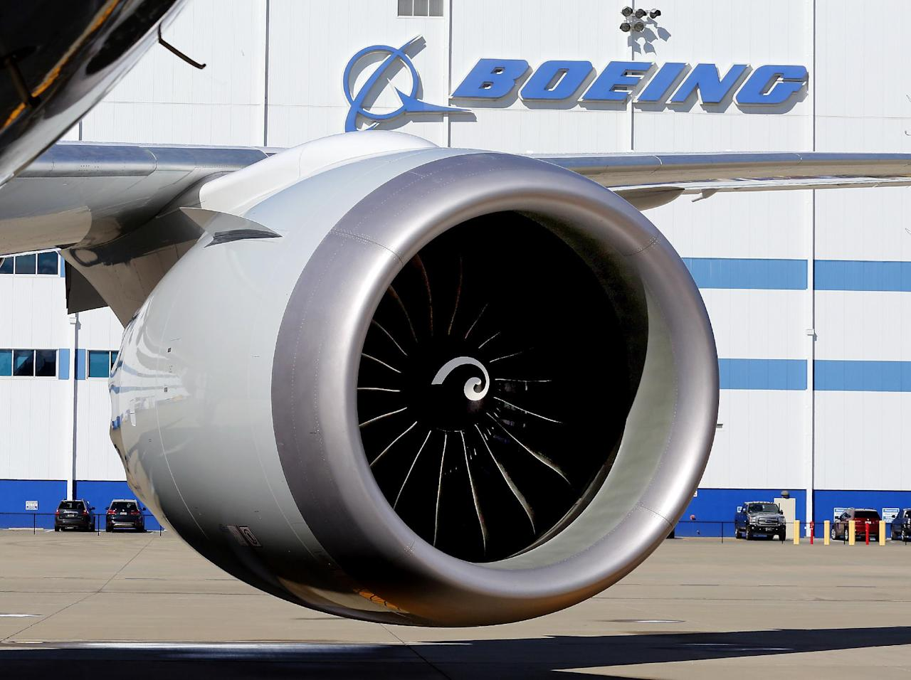 FILE - In this Tuesday, Feb. 16, 2016, file photo, an engine and part of a wing from the 100th 787 Dreamliner to be built at Boeing of South Carolina's North Charleston, S.C., facility are seen outside the plant. Boeing reports financial results on Wednesday, April 27, 2016. (Brad Nettles/The Post and Courier via AP, File) MANDATORY CREDIT