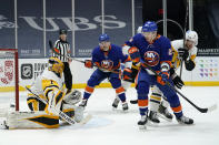 New York Islanders left wing Michael Dal Colle (28) and right-wing Oliver Wahlstrom (26) watch as Pittsburgh Penguins goaltender Casey DeSmith (1) deflects the puck during the second period of an NHL hockey game, Sunday, Feb. 28, 2021, in Uniondale, N.Y. (AP Photo/Kathy Willens)