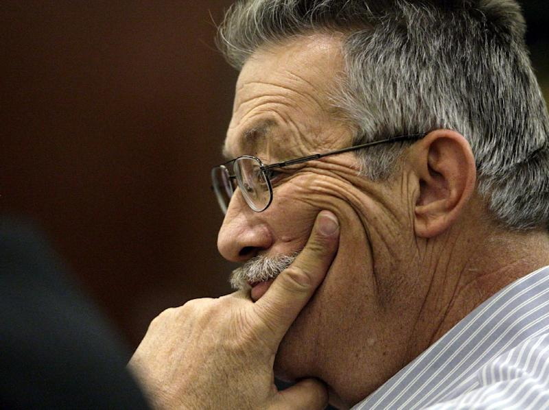Nurse-anesthetist Ronald Lakeman watches as the jury's verdict is read at the Regional Justice Center in Las Vegas on Monday, July 1, 2013. Lakeman was found guilty of 16 of 27 charges against him, but was spared a murder conviction stemming from the death of 77-year-old former Desai patient Rodolfo Meana in April 2012. (AP Photo/Las Vegas Review-Journal, Jessica Ebelhar)