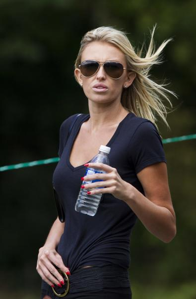 File-This July 28, 2013 file photo shows Paulina Gretzky following her boyfriend Dustin Johnson during the final round of the Canadian Open golf tournament at Glen Abbey Golf Club in Oakville, Ontario. Johnson and Gretzky have taken to Twitter to say they're getting married. (AP Photo/The Canadian Press, Aaron Lynett, File)