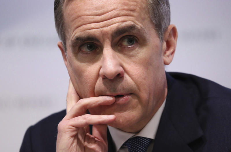 Mark Carney, Governor of the Bank of England attends the Bank of England's Monetary Policy Report news conference in the City of London, Thursday Jan. 30, 2020. The Bank of England on Thursday opted against cutting interest rates after a run of fairly firm economic data in the past week eased fears about a dramatic slowdown in the British economy. (Jonathan Brady/Pool via AP)