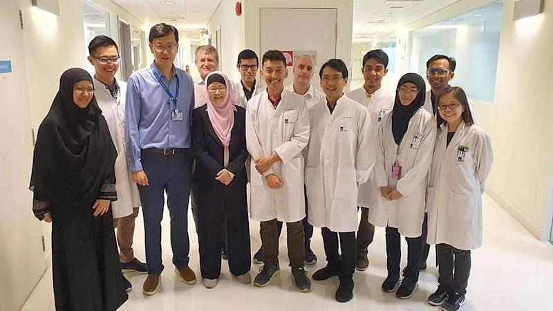 Professor Jackie Ying (in pink headgear), the head of A*Star's NanoBio Lab and her team of scientists have spent 6 weeks designing a rapid test for Covid-19 five minutes. Image: Jackie Yang