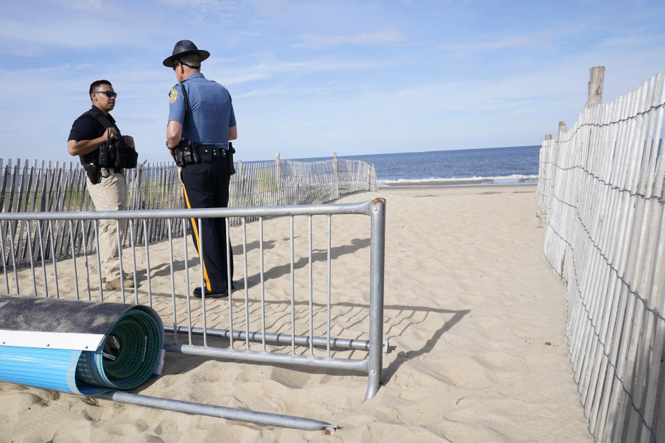 A U.S. Secret Service agent and a Delaware State Trooper guard the beach as they wait for Marine One, with President Joe Biden on board, to land at Rehoboth Beach, Del., Wednesday, June 2, 2021. Biden is spending a few days at his home in Rehoboth Beach to celebrate first lady Jill Biden's 70th birthday. (AP Photo/Susan Walsh)