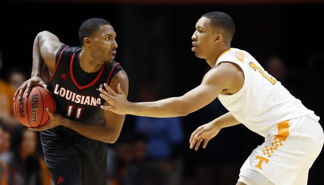 Louisiana Lafayette forward Jerekius Davis (11) looks to pass as Tennessee forward Grant Williams (2) defends during the first half of an NCAA college basketball game Friday, Nov. 9, 2018, in Knoxville, Tenn. (AP photo/Wade Payne)