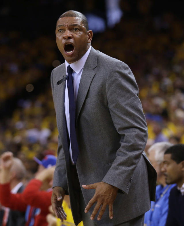 Los Angeles Clippers head coach Doc Rivers argues a call as his team plays the Golden State Warriors during the second half in Game 4 of an opening-round NBA basketball playoff series on Sunday, April 27, 2014, in Oakland, Calif. Golden State won 118-97. (AP Photo/Marcio Jose Sanchez)