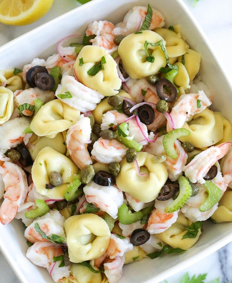 "<p>This easy lunch balances out store-bought tortellini with celery, capers, and shrimp. Get the recipe <a rel=""nofollow"" href=""http://www.skinnytaste.com/chilled-italian-shrimp-tortellini-pasta-salad?mbid=synd_yahoofood"">here</a>.</p><p><b>Per one serving:</b> <em>366 calories, 37 grams protein</em></p>"