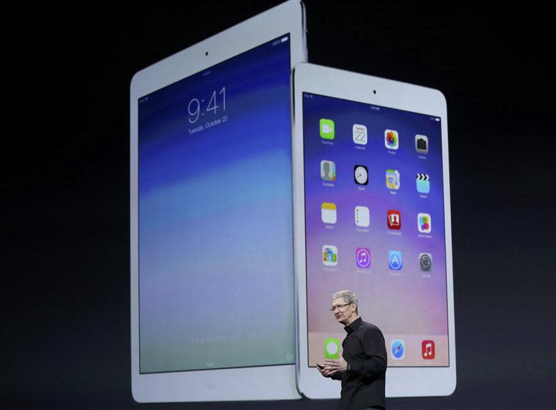 Apple Inc CEO Tim Cook speaks about the new iPad Air and the iPad mini with Retnia display during an Apple event in San Francisco