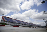 The grandstands in Darlington Raceway sit empty before the start of the NASCAR Cup Series auto race Sunday, May 17, 2020, in Darlington, S.C. (AP Photo/Brynn Anderson)
