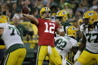 Green Bay Packers quarterback Aaron Rodgers throws a pass during the NFL football team's Family Night practice Friday Aug 2, 2019. in Green Bay, Wis. (AP Photo/Mike Roemer)