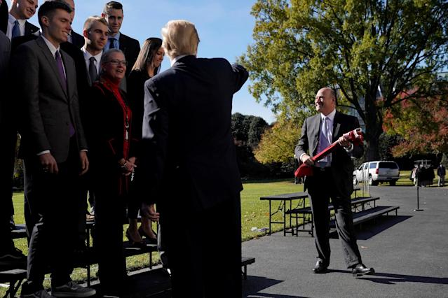 U.S. President Donald Trump points to Director of the National Economic Council Gary Cohn as he greets the Ohio State Men's Volleyball team at the White House in Washington, U.S., November 17, 2017. REUTERS/Joshua Roberts