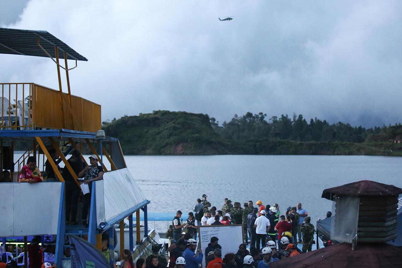 <p>Rescue officials search for survivors after the tourist boat Almirante sank in the Reservoir of Penol in Guatape municipality in Antioquia on June 25, 2017. (Joaquin Sarmiento/AFP/Getty Images) </p>