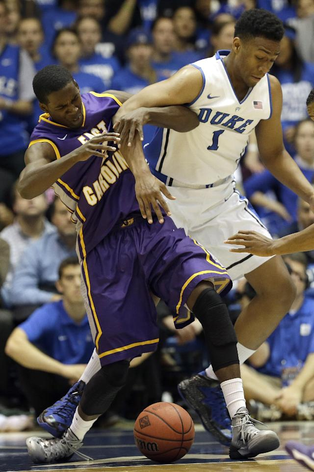 Duke's Jabari Parker (1) and East Carolina's Caleb White, left, struggle for possession of the ball during the first half of an NCAA college basketball game in Durham, N.C., Tuesday, Nov. 19, 2013. (AP Photo/Gerry Broome)