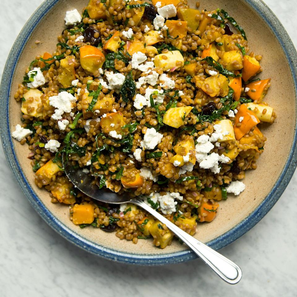 """<p>Apron guru Ellen Bennett's grain salad is a meal unto itself, combining winter squash, parsnips and wheat berries with kale, pomegranate seeds and feta cheese. It's a festive crowd-pleaser.</p><p><a href=""""https://www.foodandwine.com/recipes/wheat-berry-and-squash-salad"""">GO TO RECIPE</a></p>"""