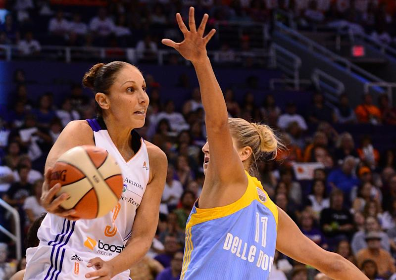 PHOENIX, AZ - SEPTEMBER 07: Guard Diana Taurasi #3 of the Phoenix Mercury makes a pass against guard Elena Delle Donne #11 of the Chicago Sky in the first half during game one of the WNBA Finals at US Airways Center on September 7, 2014 in Phoenix, Arizona. NOTE TO USER: User expressly acknowledges and agrees that, by downloading and or using this photograph, User is consenting to the terms and conditions of the Getty Images License Agreement. (Photo by Jennifer Stewart/Getty Images)