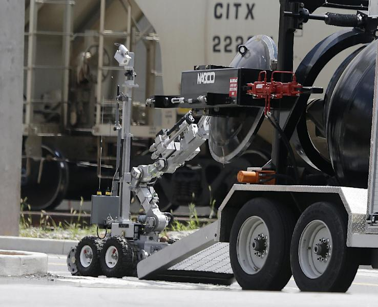 An Atlanta Police robot loads a possible Civil-War era cannonball into an explosives containment vehicle, after it was discovered at a construction site for the College Football Hall of Fame, in Atlanta, Thursday, July 18 2013. The cannonball was taken to a safe area to be further examined and disarmed if needed. (AP Photo/John Bazemore)