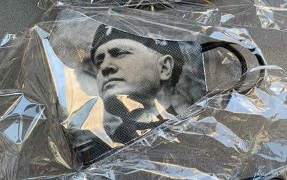 A face mask bearing the image of Mussolini is causing controversy in Italy - Twitter
