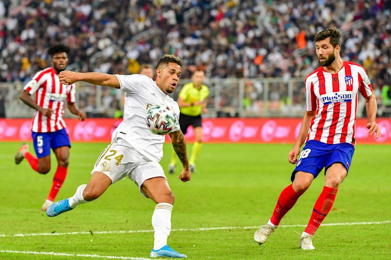 Real Madrid's Dominicans forward Mariano Diaz (C) attempts a shot next to Atletico Madrid's Brazilian defender Felipe (R) during the Spanish Super Cup final between Real Madrid and Atletico Madrid on January 12, 2020, at the King Abdullah Sports City in the Saudi Arabian port city of Jeddah. (Photo by Giuseppe CACACE / AFP) (Photo by GIUSEPPE CACACE/AFP via Getty Images)