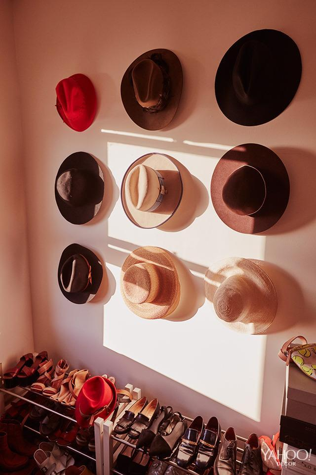 <p>I'm lucky to have an entire room for a closet. I don't think I could ever go back to having a regular closet. I love hats, and keep them stored on a wall in the room.</p>